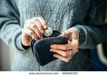 stock-photo-hands-holding-british-pound-coin-and-small-money-pouch-369962102